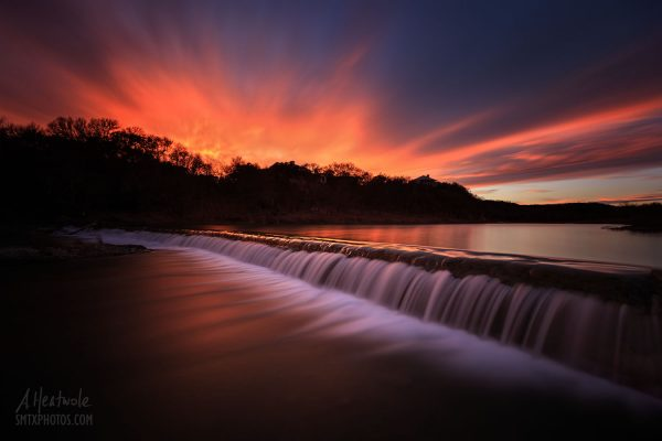 A fiery sunset on the Blanco River at 5 Mile Dam