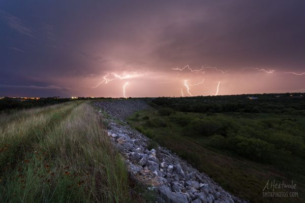 Lightning dances in the night as a storm approaches Purgatory Creek Natural Area.