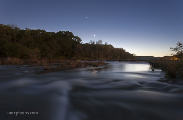 The Blanco River at dusk in at Dudley Johnson Park in San Marcos, TX