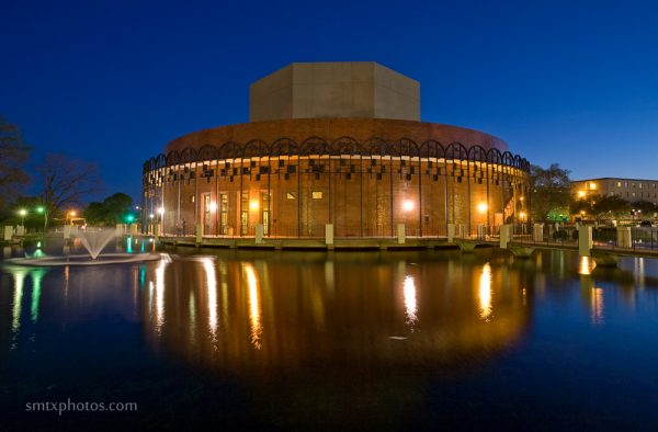 Texas State Theatre Center at night.