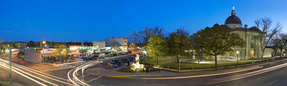A panoramic image of downtown San Marcos at night
