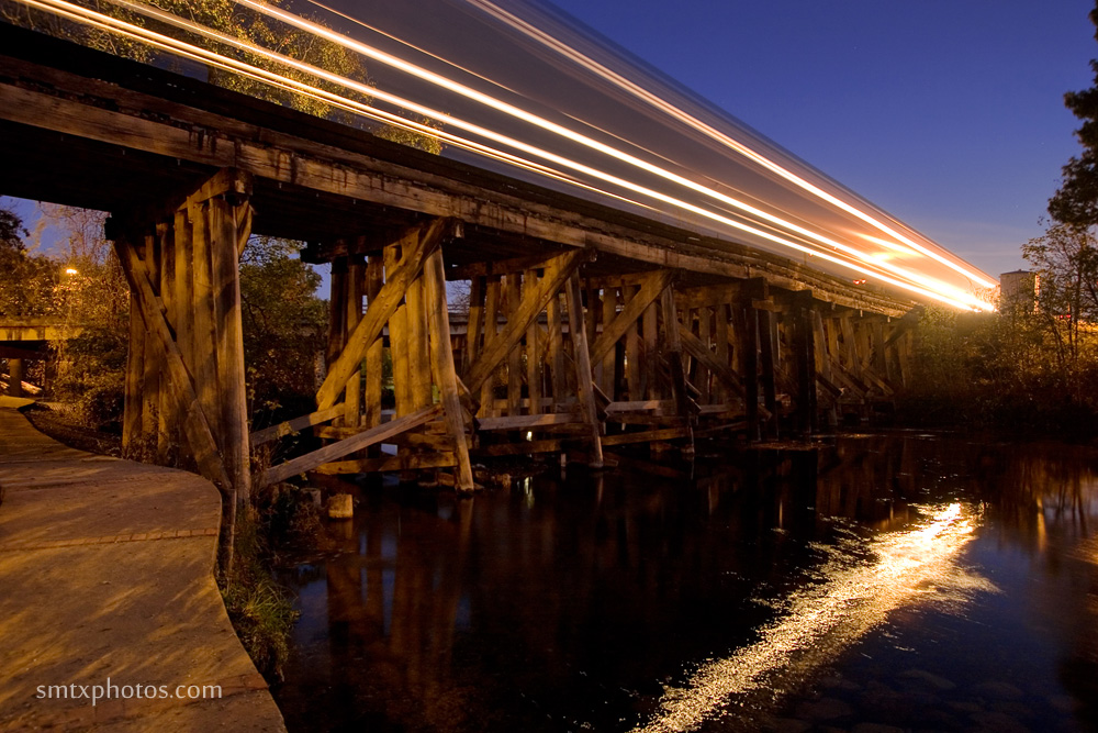 An early morning train crosses over the San Marcos River.