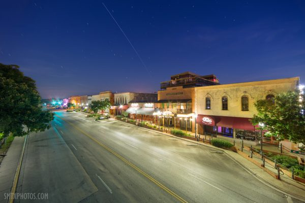 The Intnational Space Station flies over and empty downtown San Marcos, TX
