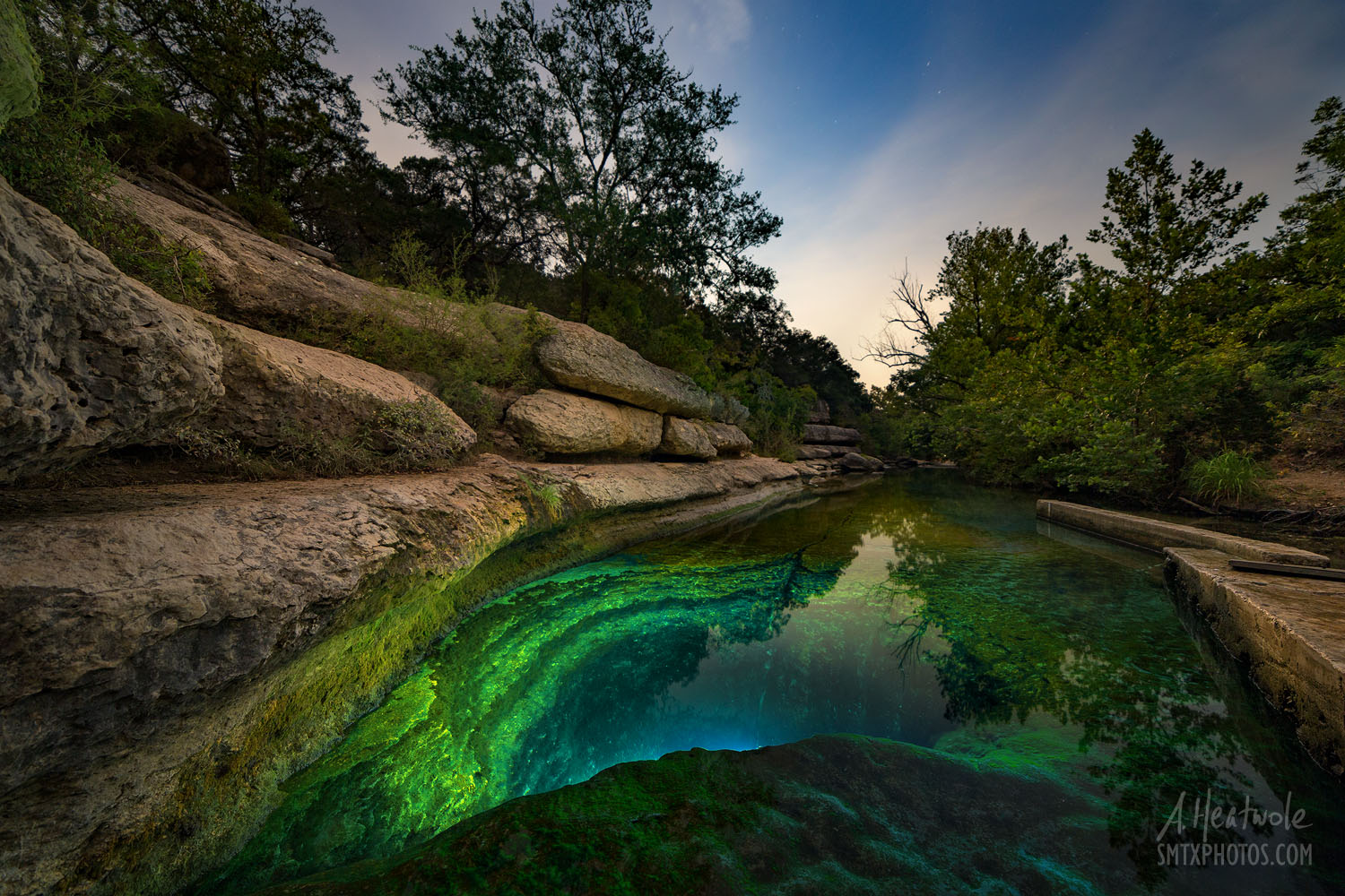 Jacob's Well in Wimberley glows under the light of a full moon.
