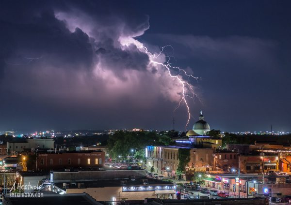 Lightning strikes over downtown San Marcos, TX.