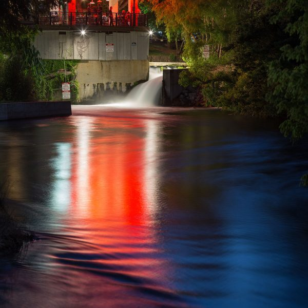 Reflections of colorful light at the headwaters of the San Marcos River.