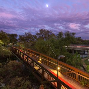 Dusk on the San Marcos River at the pedestrian bridge.