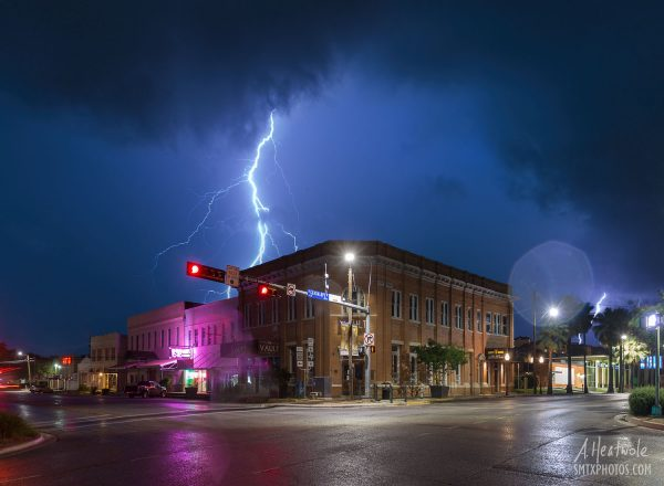 Lightning from an early morning storm strikes near downtown San Marcos.