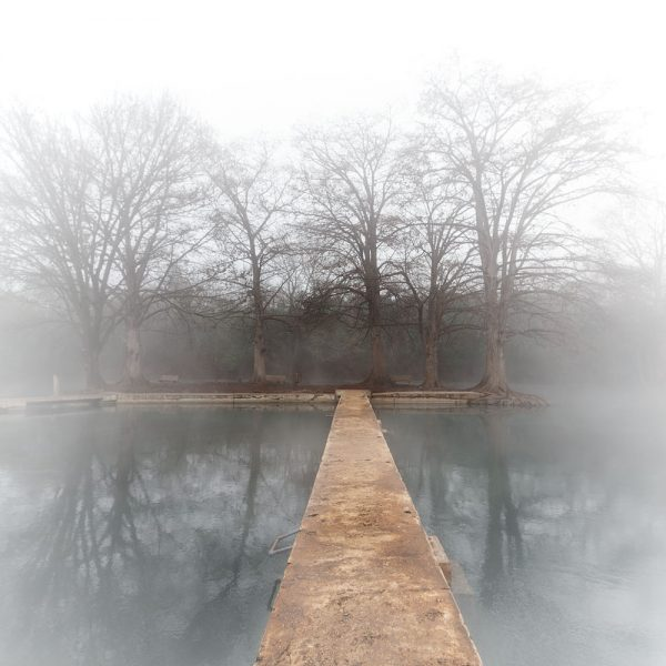 The island at Rio Vista is shrouded in fog on a chilly winter morning.