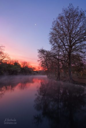 A cold and colorful day begins on the San Marcos River.