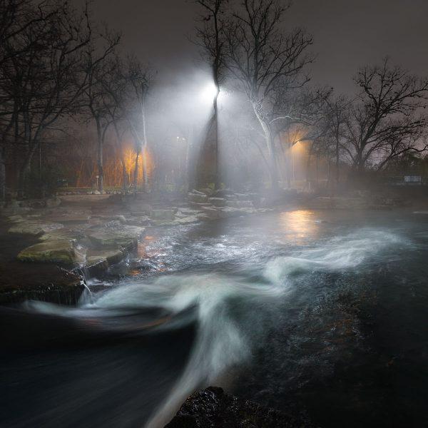Lights shine through the fog on the San Marcos River at Rio Vista.