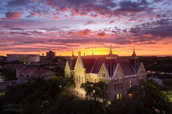 Old Main glows in the sunset on the Texas State University Campus.