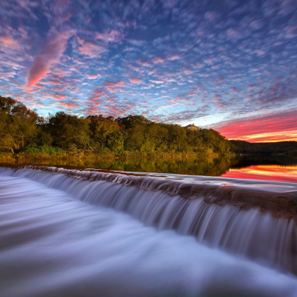 A beautiful Autumn Sunset at 5 Mile Dam in San Marcos, TX.