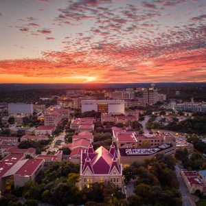 Texas State University is bathed in the warm light of a beautiful Autumn Sunset.
