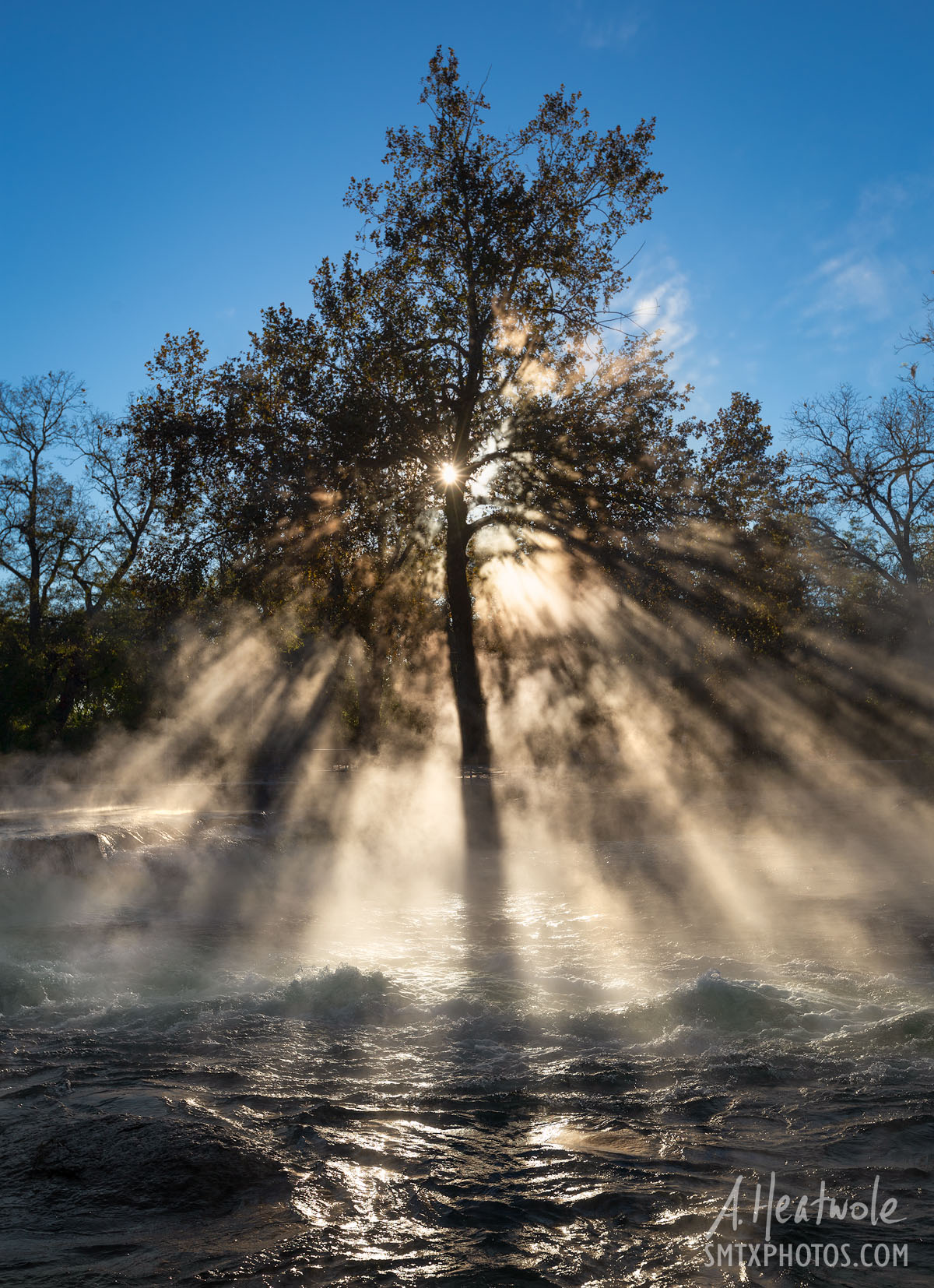 Sunlight radiates through the steam from the San Marcos River at Rio Vista on a cold morning.